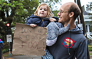 In New Orleans, Austin Alward and his daughter Iris, who is almost 4, supported the student-led climate strike on March 15. Alward learned to teach others about climate change from Al Gore's Climate Reality project after Hurricane Katrina and plans on becoming more active in raising alarm over climate change.