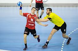 Kevin Jud of Winterthur vs Senjamin Buric of RK Gorenje during handball match between RK Gorenje Velenje (SLO) and Pfadi Winterthur (SUI) in Group Phase of EHF European Cup 2014/15, on March 8, 2015 in Rdeca dvorana, Velenje, Slovenia. Photo by Vid Ponikvar / Sportida