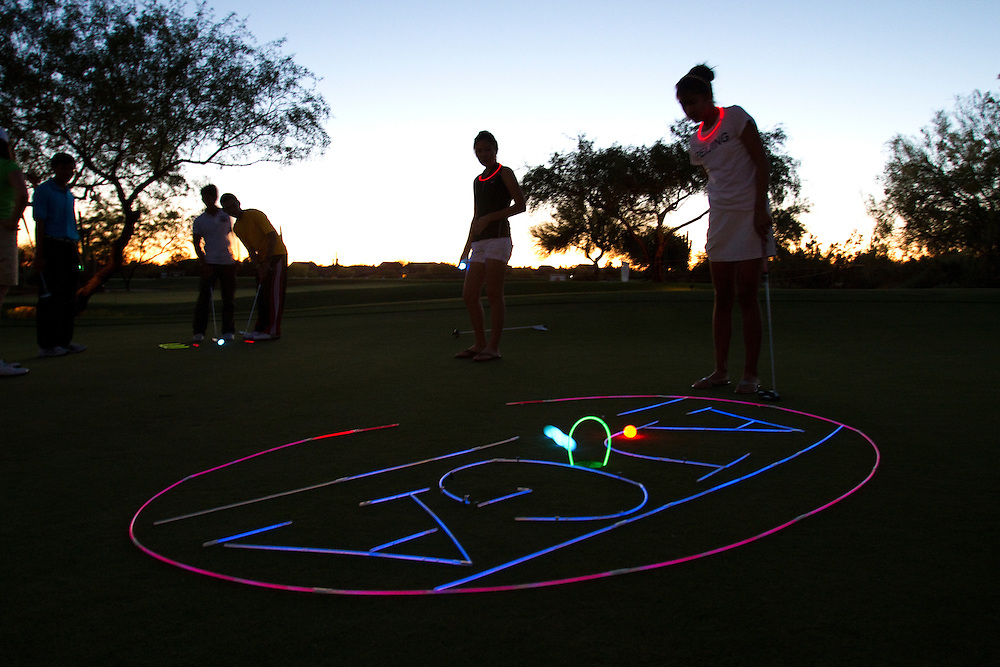 Reminders that AJGA players are still kids is the wildly popular glow in the dark putting contest that AJGA officials set up for the players at nightfall.