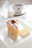 Leopold's Kafe brings together the aspects of the traditional European Café.  Austrian cuisine is their specialty from traditional dishes such as Schnitzel and Bratwurst as well as our house made pastries particularly, the Sacher Torte and the Esterhazy. Pictured here is an item from their extensive dessert list:  the Esterhazy: 5 layers of hazelnut cake filled with a light buttercream and toasted almonds.