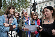 Climate change activists from the Extinction Rebellion group block the road and sing songs at Parliament Square in protest that the government is not doing enough to avoid catastrophic climate change and to demand the government take radical action to save the planet, on 24th April 2019 in London, England, United Kingdom. Extinction Rebellion is a climate change group started in 2018 and has gained a huge following of people committed to peaceful protests.
