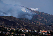 A fire fighting airplane drops water on a brush fire in Burbank, California, the United States on September 3, 2017. More than 1,000 firefighters battling what the mayor had called the biggest brush fire in the city of Los Angeles history.  (Xinhua/Zhao Hanrong)(Photo by Ringo Chiu)<br /> <br /> Usage Notes: This content is intended for editorial use only. For other uses, additional clearances may be required.