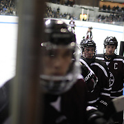 Union College players leave the rink after the first period during the Yale Vs Union College, Men's College Ice Hockey game at Ingalls Rink, New Haven, Connecticut, USA. 28th February 2014. Photo Tim Clayton