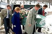 Grandchildren carrying deceased grandmother to the grave.  Minneapolis Minnesota USA