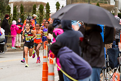 Demi Linden rounds corner in the lead near mile 18