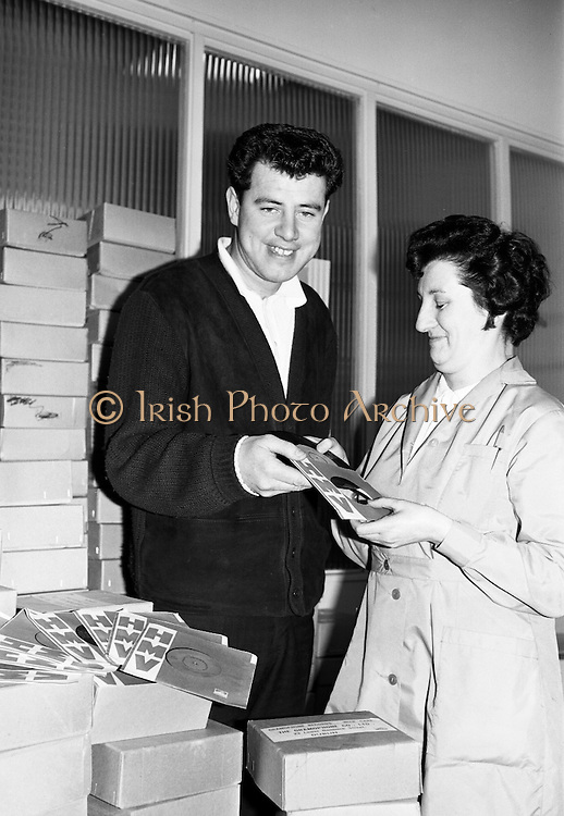 Brendan Bowyer, lead singer with the Royal Showband, picks up their latest disc from HMV at the Gramophone Company. 1964 was a huge year for the band and included the hit for which Bowyer is most remembered 'The Hucklebuck', originally on the B-side of  'I Ran All the Way Home'. .26.05.1964