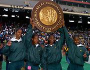 Dashanta Harris, Shana Woods, Jasmine Lee and Shalonda Solomon hold championship plaque after winning girls 4 x 400m relay in 3:36.85 in the 110th Penn Relays at  Franklin Field on Friday, April 23, 2004 in Philadelphia.