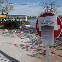 Sign informs people at the entrance public parks are ordered to be closed off from visiting for Easter weekend because of the COVID19 corona virus pandemic in Budapest, Hungary on April 10, 2020. ATTILA VOLGYI