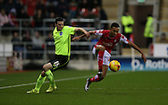 Rotherham United midfielder Grant Ward (17) goes past Brighton winger, Jamie Murphy (15) during the Sky Bet Championship match between Rotherham United and Brighton and Hove Albion at the New York Stadium, Rotherham, England on 12 January 2016.
