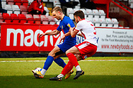 Ben Coker of Stevenage and William Hondermarck of Harrogate Town tackle during the EFL Sky Bet League 2 match between Stevenage and Harrogate Town at the Lamex Stadium, Stevenage, England on 6 March 2021.
