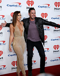 Former Bachelor stars Ashley Lanconetti and Ben Higgins attend the 2017 iHeart Radio Music Festival at T-Mobile Arena Friday, Sept. 22, 2017, in Las Vegas. Photo by Bizuayehu Tesfaye/SIPA USA