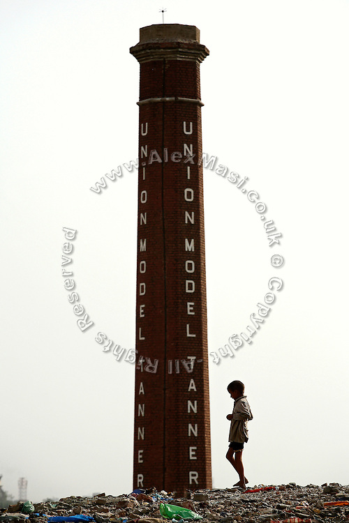 A young boy is walking on the hilltop surrounding the tannery area of Jajmau,<br /> Kanpur, Uttar Pradesh, located on the most polluted stretch of the mighty Ganges River.