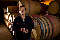 Ruth Penfold, winemaker standing in front of casks in the wine cellar, Steenberg Winery, Constantia Valley (near Cape Town), South Africa