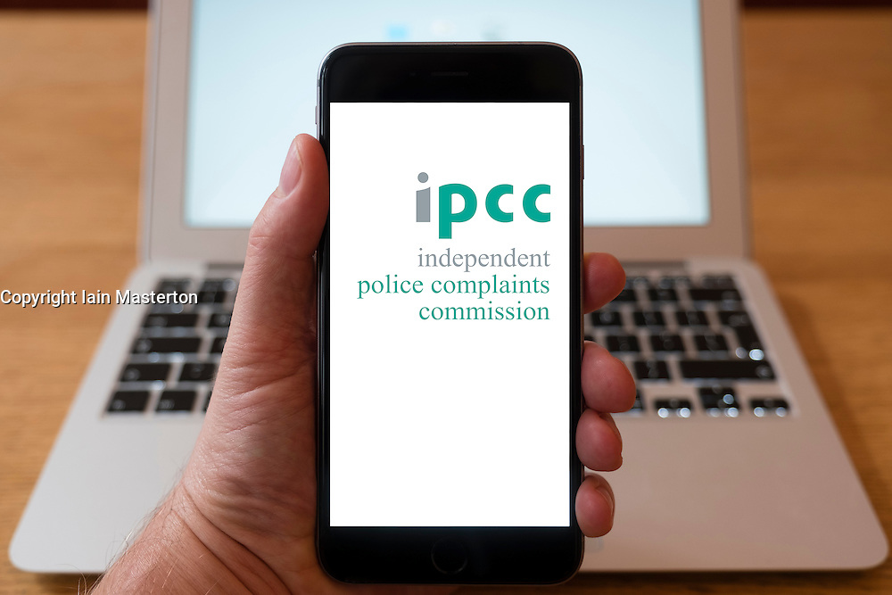 Using iPhone smartphone to display logo of IPCC, Independent Police Complaints Commission