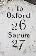 Milepost giving distances to Oxford and Sarum from Hungerford, Berkshire, England, UK