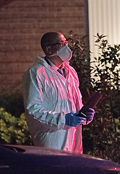 © Licensed to London News Pictures 18/09/2021. <br /> Kidbrooke, UK, Officer in forensic suit. A large police cordon is in place in Kidbrooke, South East London tonight after the body of a woman was found near a community centre. A man from Lewisham has been arrested on suspicion of murder. Photo credit:Grant Falvey/LNP