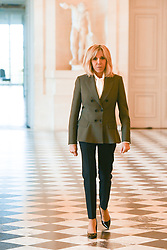 French President's wife Brigitte Macron welcomes spouses during an event at the Chateau de Versailles in Versailles, near Paris, on November 11, 2018 as part of commemorations marking the 100th anniversary of the 11 November 1918 armistice, ending World War I. Photo By Laurent Zabulon/ABACAPRESS.COM