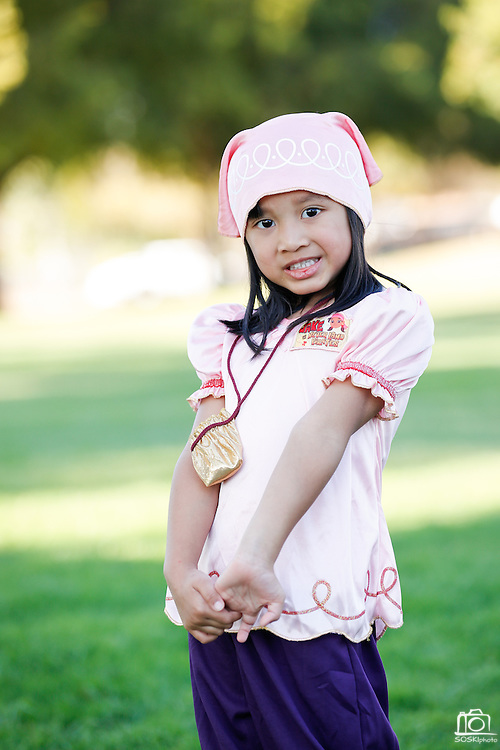 Audrey Baterna, 3, of Milpitas wears a pirate costume during the annual Sunnyhills Neighborhood Association's Sunnyhills Pre-Halloween Party at Albert Augustine Jr. Memorial Park in Milpitas, California, on October 26, 2013. (Stan Olszewski/SOSKIphoto)