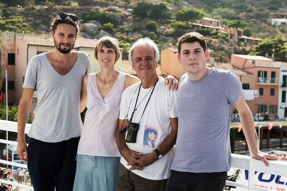 GIGLIO ISLAND, ITALY - 25 August 2013: Editorial photo with Gianni Cipriano (photographer), Luisa Brandl (Stern), Elio Vincenzi (husband of the missing and presumed dead Costa Concordia passenger Mariagrazia Trecarichi, and Raphael Geiger (Stern) on the ferry bythe  Giglio Island, Italy, on August 25th 2013.<br /> <br /> On 13 January 2012 at about 9:45 pm, in calm seas and overcast weather, under command of Captain Francesco Schettino, Costa Concordia struck a rock in the Tyrrhenian Sea just off the eastern shore of Isola del Giglio. Of the 3,229 passengers and 1,023 crew known to have been aboard, 30 people died, and two more passengers are missing and presumed dead, inclusding Mrs Trecarichi. Mariagrazia Trecarichi had survived two cancers and decided to celebrate her 50th birthday on the Costa Concordia.