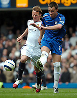 Photo: Ed Godden.<br />Chelsea v West Ham United. The Barclays Premiership. 09/04/2006. Teddy Sheringham (L) and Chelsea player John Terry.