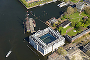 Nederland, Noord-Holland, Amsterdam, 09-04-2014;<br /> Detail Scheepvaartmuseum  met replica VOC-schip Amsterdam, rechts het marineterrein. <br /> Close up navy area (right) and the National Maritime Museum (white building)<br /> luchtfoto (toeslag op standard tarieven);<br /> aerial photo (additional fee required);<br /> copyright foto/photo Siebe Swart