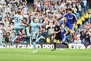 Chelsea's Diego Costa ® challenges Man city's Fernandhino (l). Barclays premier league match, Manchester city v Chelsea at the Etihad stadium in Manchester,Lancs on Sunday 21st Sept 2014<br /> pic by Andrew Orchard, Andrew Orchard sports photography.