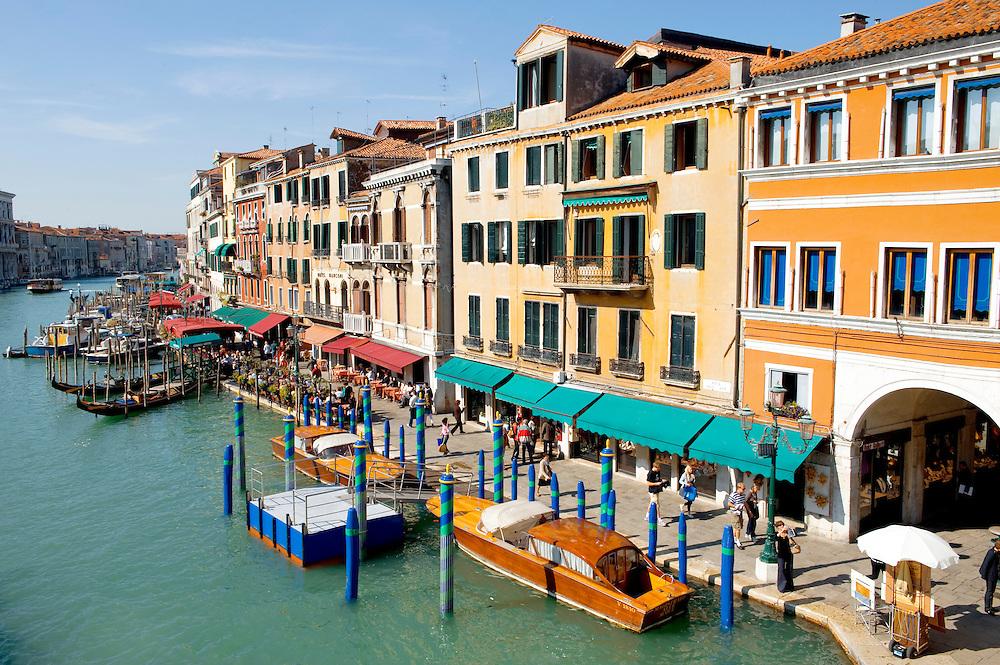 Grand Canal Venice at the Rialto with gondolas. Venice Italy