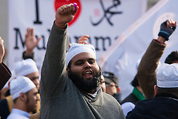 "London, February 8th 2015. Muslims demonstrate outside Downing Street  ""to denounce the uncivilised expressionists reprinting of the cartoon image of the Holy Prophet Muhammad"". PICTURED: Muslims chant slogans as counter-protesters from Britain First and the English Defence League hurl insults across Whitehall."