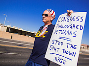 02 OCTOBER 2013 - GLENDALE, AZ: A veteran and furloughed civilian employee at Luke Air Force Base, was one of about 30 people who picketed the base Wednesday. The furloughed workers, all civilian employees and members of AFGE at Luke Air Force Base, protested the partial shutdown of the US government. The American Federation of Government Employees (AFGE) is the largest federal employee union representing 650,000 federal and D.C. government workers. Similar protests were held across the country as the partial government shutdown entered its second day.    PHOTO BY JACK KURTZ