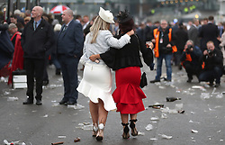 Racegoers are surrounded by rubbish as they leave the course on Ladies Day of the 2018 Randox Health Grand National Festival at Aintree Racecourse, Liverpool.