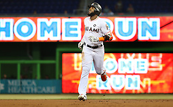 May 31, 2017 - Miami, FL, USA - Miami Marlins left fielder Marcell Ozuna hits a two-run home run in the first inning against the Philadelphia Phillies on Wednesday, May 31, 2017 at Marlins Park in Little Havana in Miami, Fla. (Credit Image: © Pedro Portal/TNS via ZUMA Wire)