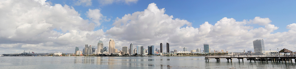 Ultra wide view of the downtown skyline covers from the Midway Aircraft Carrier on the far left to the Hilton Hotel and Coronado Ferry Terminal on the right. <br /> <br /> Panorama available up to 12001 x 2837.