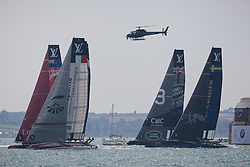 © Licensed to London News Pictures. 22/07/2016. Portsmouth, United Kingdom.  America's Cup teams in a practice race for the America's Cup World Series (ACWS) in Portsmouth this weekend, 22nd-24th July 2016. British Olympic sailing legend, Sir Ben Ainslie, is leading his all-British team, Land Rover BAR, against other teams in a battle to qualify for a place in the two team America's Cup final, to be held in Bermuda in 2017. Today (22/07/16) is a practice day, followed by two days of racing. Photo credit: Rob Arnold/LNP