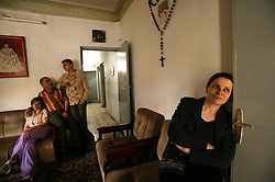 Rita Elias, 30, is seen inside of her home in Baghdad, Iraq, March 6, 2004. Elias is a former stockbroker who now works for a bank in Baghdad. Her house was partially damaged in the war. In a family of 11 children, Elias has two sisters who live in the United States and a brother-in-law who is an Iraqi-American working as a translator in Iraq for the Department of Defense.