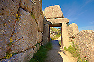 """The North Postern (Gate) of Mycenae ( 1250 B.C). Made from four Monolithic blocks of """"Almond Stone"""" in a typical form of two upright jams, A lintel over the top and threshold. Mycenae UNESCO World Heritage  Archaeological Site, Peloponnese, Greece . <br /> <br /> Visit our MYCENAEN ART PHOTO COLLECTIONS for more photos to download  as wall art prints https://funkystock.photoshelter.com/gallery-collection/Pictures-Images-of-Ancient-Mycenaean-Art-Artefacts-Archaeology-Sites/C0000xRC5WLQcbhQ<br /> .<br /> <br /> Visit our GREEK HISTORIC PLACES PHOTO COLLECTIONS for more photos to download or buy as wall art prints https://funkystock.photoshelter.com/gallery-collection/Pictures-Images-of-Greece-Photos-of-Greek-Historic-Landmark-Sites/C0000w6e8OkknEb8"""