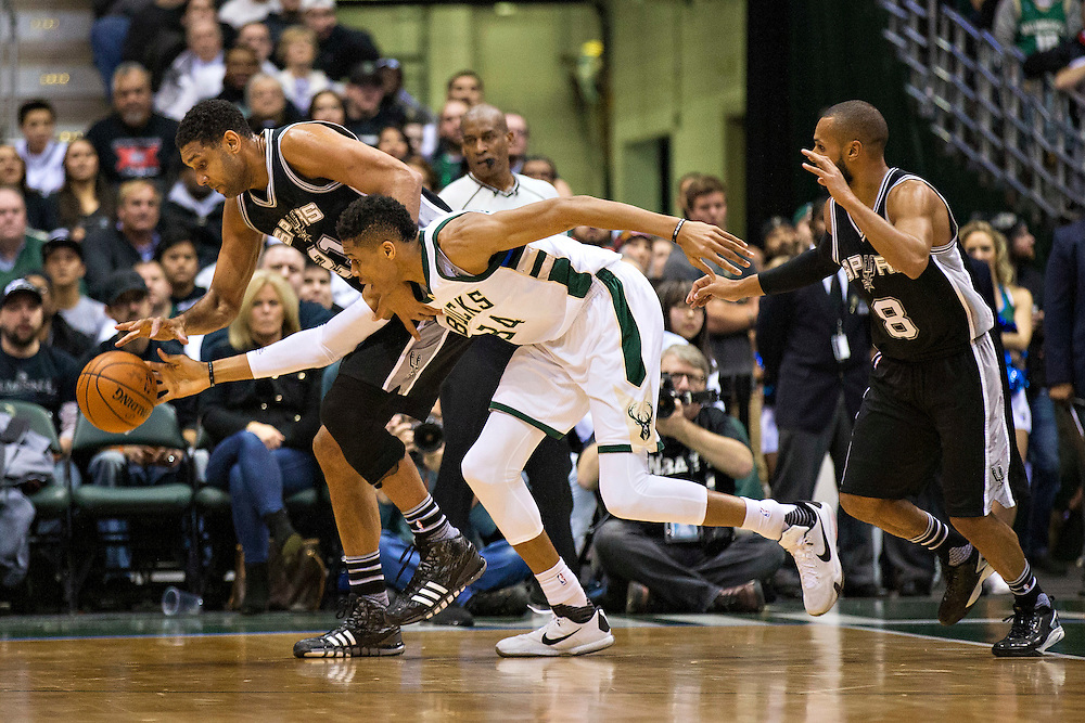 """MILWAUKEE, WI- JANUARY 4:  Tim Duncan #21 of the San Antonio Spurs dunks the basket ball over Glannis Antetokounmpo #34 of the Milwaukee Bucks at BMO Harris Bradley Center on January 4, 2016 in Milwaukee, Wisconsin.  """"NOTE TO USER: User expressly acknowledges and agrees that, by downloading and or using this photograph, User is consenting to the terms and conditions of the Getty Images License Agreement.""""(Photo by Wesley Hitt/Getty Images) *** Local Caption *** Glannis Antetokounmpo, Tim Duncan"""