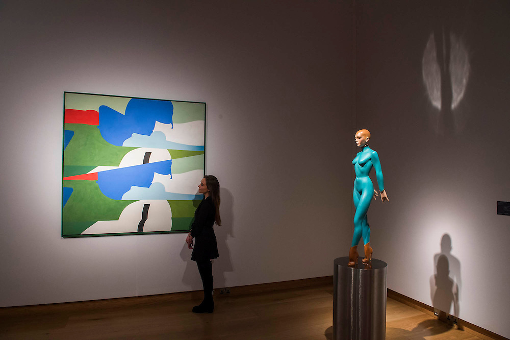 Anthony Donaldson's For Jim Clark (estimate: £60,000-80,000, left based on a photo of the British Formula one racing driver) and Enchanteresse by Allen Jones (estimate: £60,000-80,000) - Christie's Modern British and Irish Art Sale which will take place on 19 November 2014. Featuring 35 lots, the auction includes  examples of 20th century British sculpture and painting, such as: John Duncan Fergusson's Poise (estimate: £80,000-120,000); six paintings by L.S. Lowry, led by Coal Barge (estimate: £700,000-1,000,000);  Euan Uglow's masterpiece entitled Three In One (estimate: £500,000-800,000; Figure (Sunion) by Dame Barbara Hepworth (estimate: £600,000-800,000); and sculpture by leading artists of the genre including Henry Moore, Lynn Chadwick, Dame Elisabeth Frink, and Naum Gabo.