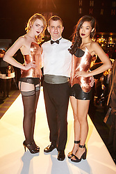 © Licensed to London News Pictures.  05/11/2014. OXFORD, UK. Oxford Fashion Week SS15 Lingerie Show at the Malmaison Hotel in Oxford. <br /> <br /> In this picture: Ex Formula One engineer turned designer Jon Harris (centre) pictured with models wearing copper corsets he created. Each corset has to be custom made to the model's exact measurements.  <br /> <br /> Photo credit: Cliff Hide/LNP