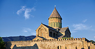 Pictures & images of the exterior and wall around the Eastern Orthodox Georgian Svetitskhoveli Cathedral (Cathedral of the Living Pillar) , Mtskheta, Georgia (country). A UNESCO World Heritage Site.<br /> <br /> Currently the second largest church building in Georgia, Svetitskhoveli Cathedral is a masterpiece of Early Medieval architecture completed in 1029 by Georgian architect Arsukisdze on an earlier site dating back toi the 4th century. .<br /> <br /> Visit our MEDIEVAL PHOTO COLLECTIONS for more   photos  to download or buy as prints https://funkystock.photoshelter.com/gallery-collection/Medieval-Middle-Ages-Historic-Places-Arcaeological-Sites-Pictures-Images-of/C0000B5ZA54_WD0s<br /> <br /> Visit our REPUBLIC of GEORGIA HISTORIC PLACES PHOTO COLLECTIONS for more photos to browse, download or buy as wall art prints https://funkystock.photoshelter.com/gallery-collection/Pictures-Images-of-Georgia-Country-Historic-Landmark-Places-Museum-Antiquities/C0000c1oD9eVkh9c