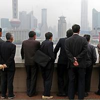 Asia, China, Shanghai. Businessmen on the Bund.