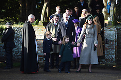 The Duke of Cambridge and The Duchess of Cambridge with their children Prince George and Princess Charlotte after attending the Christmas Day morning church service at St Mary Magdalene Church in Sandringham, Norfolk.