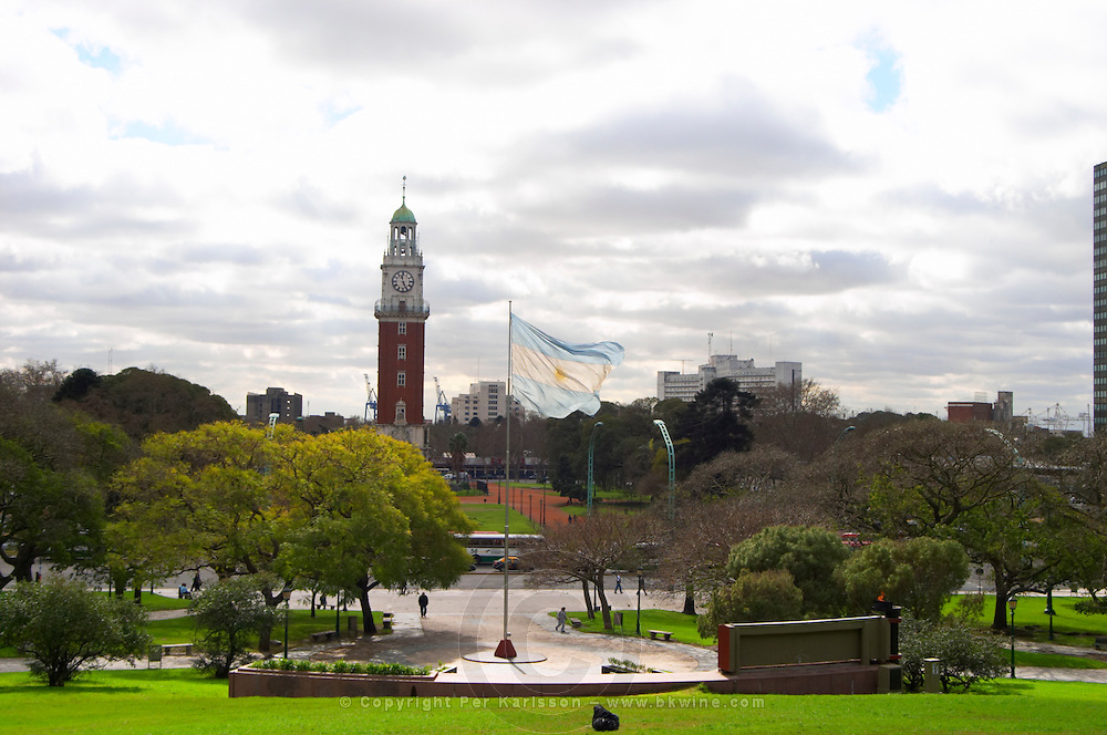 the Plaza San Martin Square renamed Plaza de la Fuerza Aerea or Plaza Fuerza Retiro, view over the torre de los Ingleses renamed torre monumental, the Englishmen's tower, an Argentinian flag blowing in the wind in front of the monument of the Islas Malvinas Falkland Island war. Buenos Aires Argentina, South America