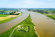 Nederland, Gelderland, Gemeente Lingewaard, 09-06-2016; de Pannerdensche Kop gezien in Zuidoostelijke richting, de Rijn splitst zich hier in Waal (rechts, richting Nijmegen) en Pannerdensch Kanaal (links, overgaand in Neder-Rijn richting Arnhem). Door de overvloedige regenval in Duitsland is er sprake van hoogwater. <br /> Op de landtong Fort Pannerden, onderdeel van de Nieuwe Hollandse Waterlinie. <br /> <br /> The Rhine bifurcates into river Waal and Pannerdensch Channel (right, becoming Lower Rhine direction of Arnhem). The former Fort Pannerden is located about halfway between the headland. Because of the abundant rainfall in Germany, there is high water.<br /> luchtfoto (toeslag op standard tarieven);<br /> aerial photo (additional fee required);<br /> copyright foto/photo Siebe Swart