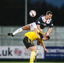 Falkirk's David McCracken over  Livingston Andy Barrowman.<br /> Falkirk 4 v 1 Livingston, Scottish Championship game played today at the Falkirk Stadium.