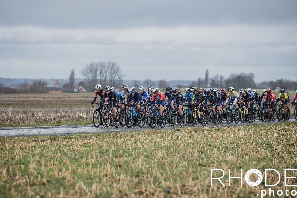 Peloton over the Huisepontweg cobbles<br /> <br /> 2nd Nokere Koerse WE (BEL) 2021<br /> UCI Women Elite 1.PRO<br /> One Day Race: Deinze > Nokere 124km