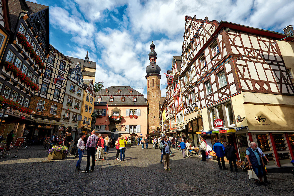 View of the Cochem Town Square, Bustling Market, Shoppers, and Tower, Cochem, Germany.