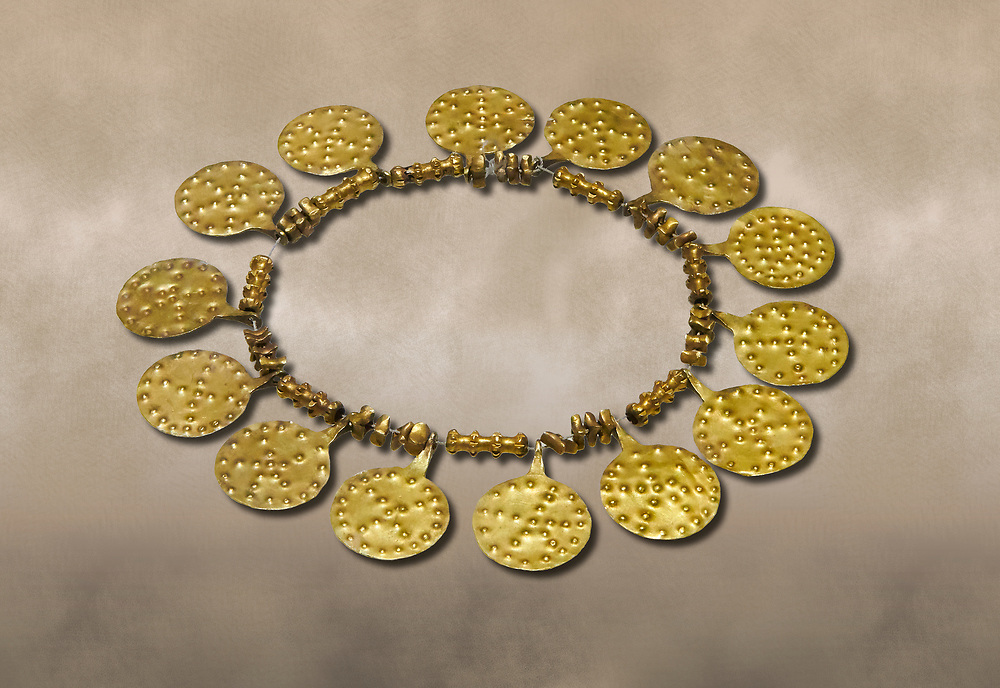 Bronze Age Hattian gold necklace from Grave E,  possibly a Bronze Age Royal grave (2500 BC to 2250 BC) - Alacahoyuk - Museum of Anatolian Civilisations, Ankara, Turkey. Against a warm art background .<br /> <br /> If you prefer to buy from our ALAMY PHOTO LIBRARY  Collection visit : https://www.alamy.com/portfolio/paul-williams-funkystock/royal-tombs-alaca-hoyuk-bronze-age.html (TIP refine search by adding background colour in the LOWER search box)<br /> <br /> Visit our ANCIENT WORLD PHOTO COLLECTIONS for more photos to download or buy as wall art prints https://funkystock.photoshelter.com/gallery-collection/Ancient-World-Art-Antiquities-Historic-Sites-Pictures-Images-of/C00006u26yqSkDOM