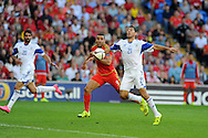 Hal Robson-Kanu of Wales (9) looks on as the ball appears to hit the arm of Eytan Tibi of Israel but despite appeals for handball to referee Ivan Bebek no penalty is given.  Euro 2016 qualifying match, Wales v Israel at the Cardiff city stadium in Cardiff, South Wales on Sunday 6th Sept 2015.  pic by Andrew Orchard, Andrew Orchard sports photography.