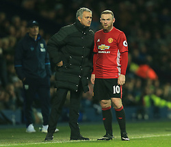 17 December 2016 - Premier League - West Bromwich Albion v Manchester United - Manchester United manager Jose Mourniho talks to  Wayne Rooney of Manchester United - Photo: Paul Roberts / Offside.