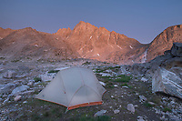 Alpenglow over backcountry camp in Indian Basin, Harrower Peak is in the distance, Bridger Wilderness,  Wind River Range Wyoming